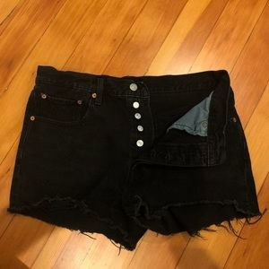 Distressed black Levi shorts